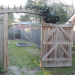 wood gate with arbor